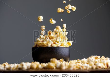 Levitating Falling Popcorn In A Ceramic Cup And Around It.