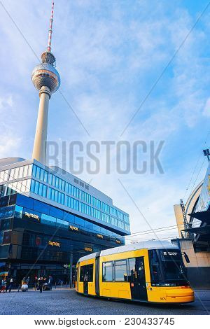 Berlin, Germany - December 10, 2017: Running Bus On Alexanderplatz With Television Tower On The Back