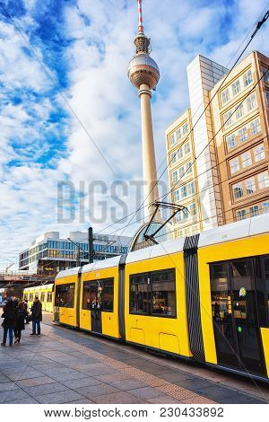 Berlin, Germany - December 10, 2017: Running Tram On Alexanderplatz With Television Tower On The Bac