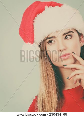 Xmas, Seasonal Clothing, Winter Christmas Concept. Young Woman Wearing Santa Claus Helper Costume Th