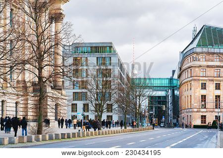 Berlin, Germany - December 8, 2017: People At Government Buildings Near Reichstag And Television Tow