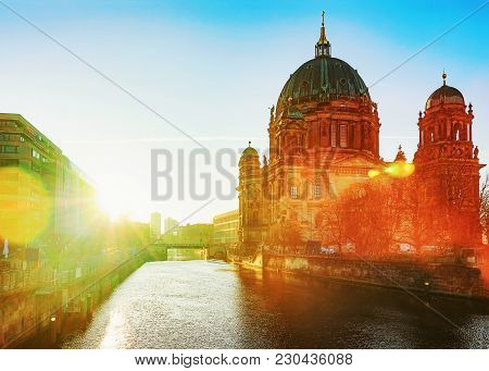 Wonderful Sunrise At Berliner Dom Cathedral In Berlin, Germany. Special Sun Flare