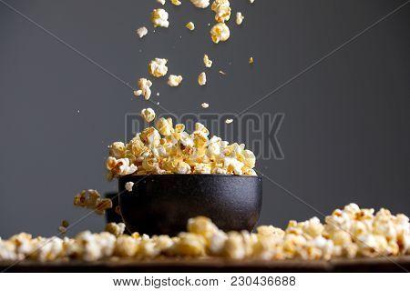 Levitating Popcorn Around A Ceramic Cup.