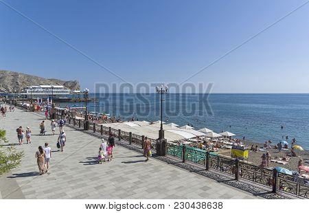 Sudak, Crimea - September 3, 2017:  Embankment And Beach In The Central Part Of The Sudak Bay, Crime
