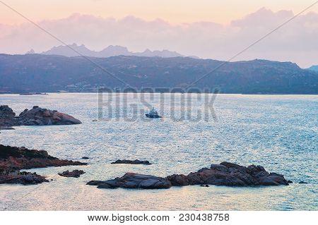 Sunrise With Ship In Baja Sardinia At Mediterranean Sea, Sardinia, Italy