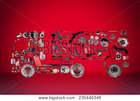 Images Truck Assembled From New Spare Parts On Red Background. Truck With A Trailer And With Cargo