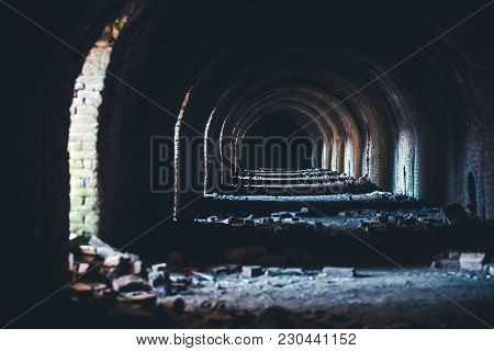 Interior Of The Destroyed Buildings Of Old Factory. Ruins Of An Industrial Enterprise, Dark Fragment