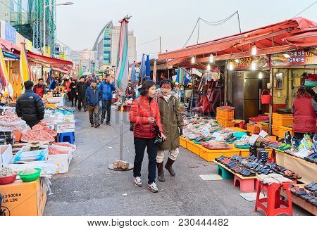 Busan, South Korea - March 12, 2016: Customers In The Street Fish Market In Jagalchi In Busan, South