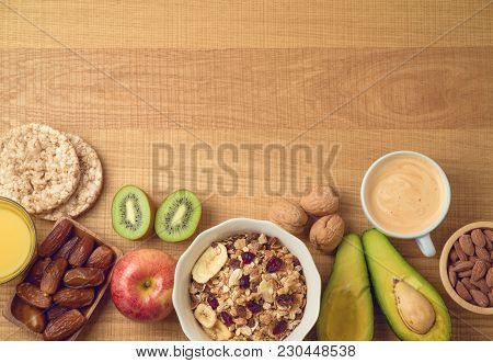 Healthy Breakfast Concept With Muesli, Avocado, Kiwi, Orange Juce And Coffee Cup. Top View