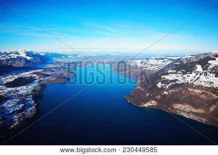 The Center Of Bernese Apline City Of Interlaken At Winter Swiss Alps, Helicopter View. Thunersee On