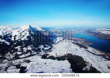The Center Of Bernese Apline City In Interlaken At Winter Swiss Alps, Helicopter View. Thunersee On
