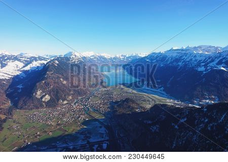 The Center Of Bernese Apline City In Interlaken At Winter Swiss Alps, Helicopter View. Brienz Lake O
