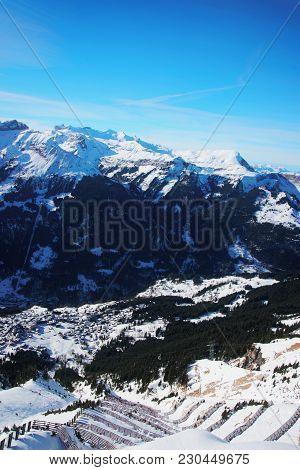 Aerial View To Wengen Village And Lauterbrunnen Town In Bernese Oberland In Switzerland.