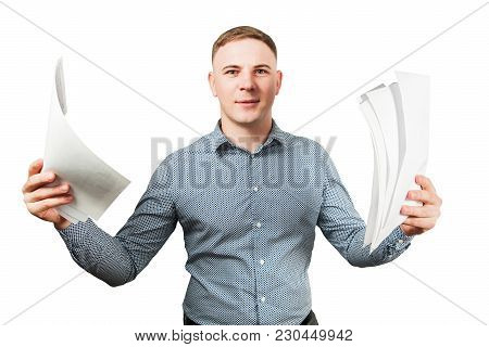 Portrait Of Frowning Young Guy Holding Papper Sheets And Spreads His Hands. Isolated On White.
