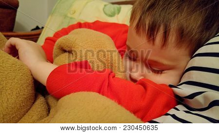 Sleeping Kid Caucasian Child Boy. Sweet Dreams. Deep Sleep, Tired After Game Play Sleeping Child Sto