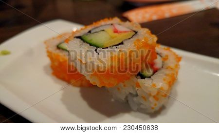 Sushi Inside Out With Avocado, Crab Stick And Omelette. Delicious Sushi Close Up.