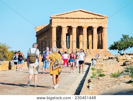 Agrigento, Italy - September 22, 2017: Tourists At Temple Of Concordia In Agrigento In Sicily, Italy