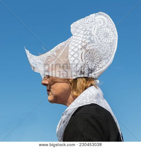 Urk, The Netherlands - September 02, 2017: Woman With Traditional Clothing And Headgear At A Local F
