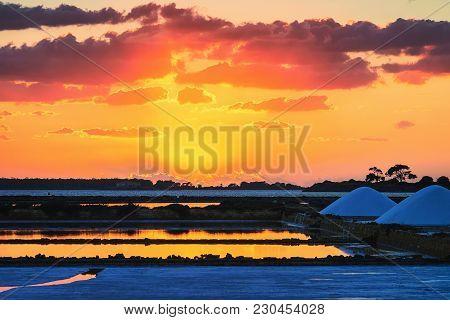 Sunset At Salt Evaporation Pond At Marsala, Sicily Island, Italy