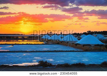 Sunset At Salt Evaporation Pond In Marsala, Sicily Island Of Italy
