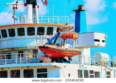 Sailboat In A Large Passenger Ferry, Messina, Sicily, Italy