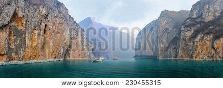 Two Barges With Sand And Gravel In The River Yangtze Between Its Steep Shores