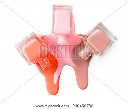 3 Pink Color Nail Polish Isolated On White Background