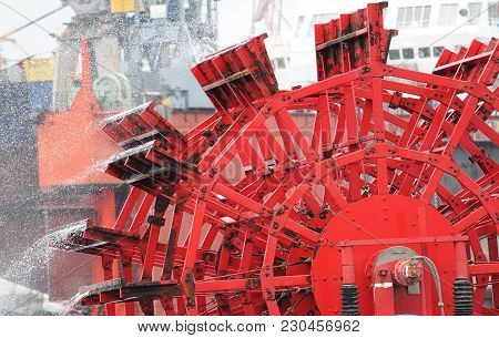 Detail Of A Red Paddlewheel On The River