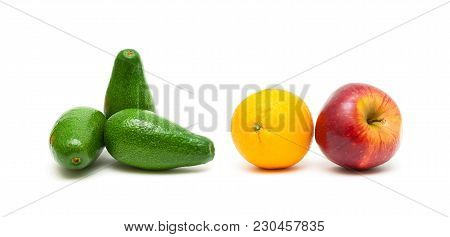 Avocado, Apples And Oranges On A White Background. Horizontal Photo.