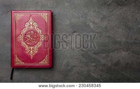 Holy book of Muslims on gray background