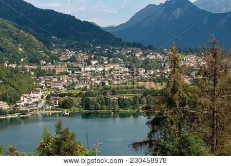 Aerial View Of The Small Town Of Levico Terme With The Lake And The Mountains. Trentino Alto Adige,
