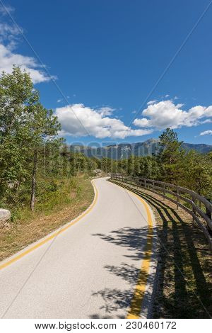 Bicycle Path In The Sarca Valley (valle Del Sarca) Through The Forest. Trentino Alto Adige, Italy, E