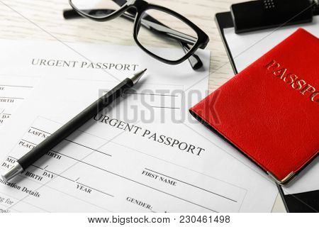 Passport and application forms on table. Immigration reform