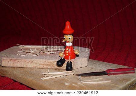 Background With Pinocchio Wooden Doll And Wood Chips