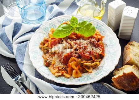 A Plate Of Pasta Farfalle With Tomato Sauce And Green Peas. Healthy Vegetarian Food