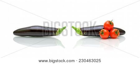 Eggplants And Cherry Tomatoes On A White Background. Horizontal Photo.