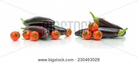 Cherry Tomatoes And Eggplants On A White Background. Horizontal Photo.