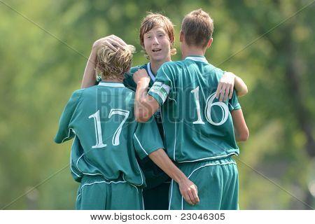 KAPOSVAR, HUNGARY - AUGUST 27: Kaposvar players celebrate at the Hungarian National Championship under 18 game between Kaposvar (green) and Gyor (white) August 27, 2011 in Kaposvar, Hungary.