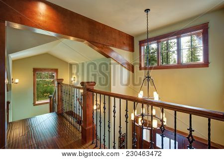 Second Floor Landing Features Stained Handrails And Black Iron Spindles, Beautiful Chandelier Hangin
