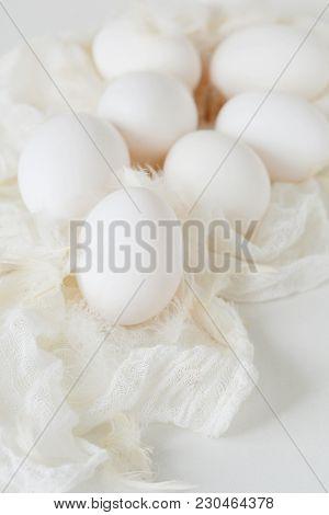 White Chicken Eggs On A White Background In High Key. Fresh Chicken Egg. Easter Egg.  Easter.