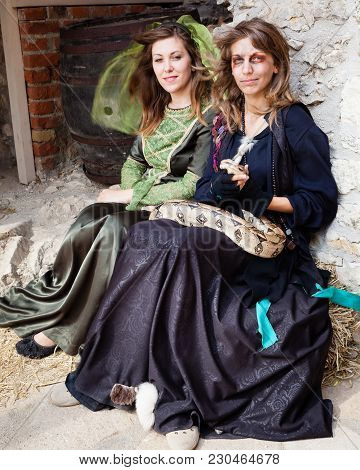 Sumeg Castle, Sumeg / Hungary - August 03, 2012 - Two Girls Dresses In Middle Evel Attire Clothing A