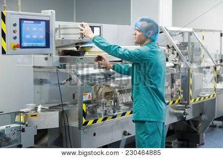 Pharmaceutical Technician In Sterile Working Conditions At Pharmacy Industry