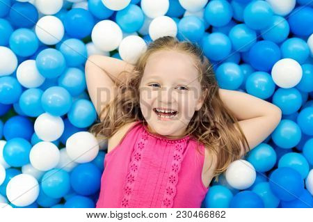 Kids Play In Ball Pit. Child Playing In Balls Pool