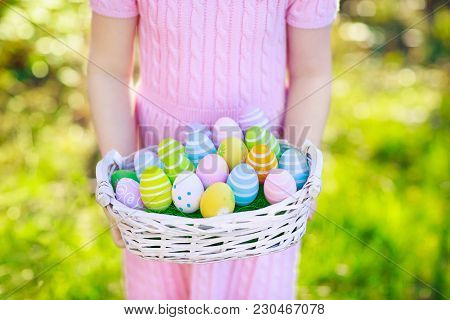 Kids On Easter Egg Hunt With Eggs Basket.