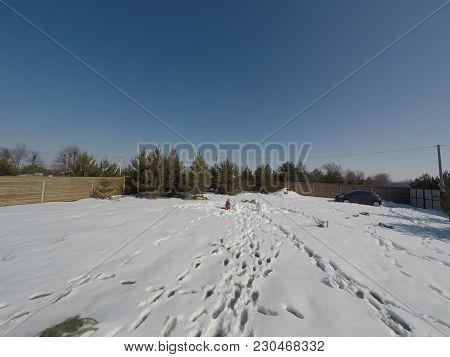 Plot Of Land In Winter. Construction Of A Private House. Fence On The Land In Winter.