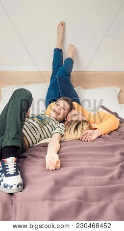 Mother With Son On Bed, Mother And Son Having Fun, Happy Mom And Her Teenager Son Lying On Bed, Moth