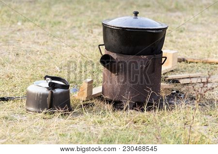 Cauldron Of Soup On The Nature . In The Park In Nature