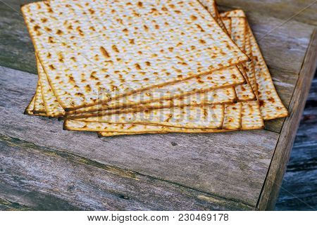 Closeup Of Passover Matzah Passover Background. Matzoh Over Wooden Table