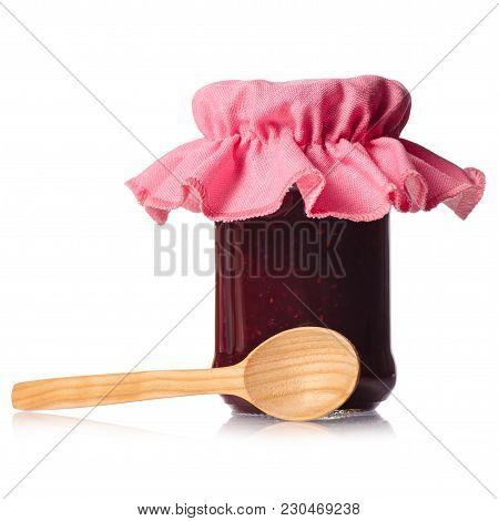 Raspberry Jam In A Jar Wooden Spoon On White Background Isolation