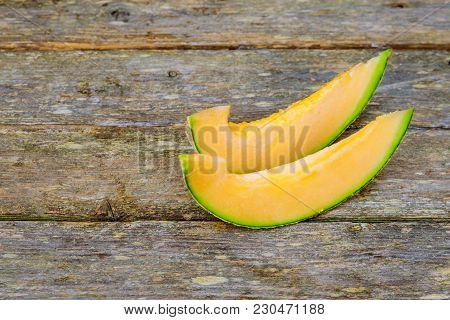 Fresh Honeydew Melon Wooden Board With Yummy Melon Slices On Table